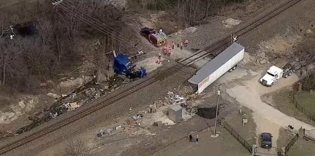 Train crashes into 18-wheeler stuck on tracks in Denton County