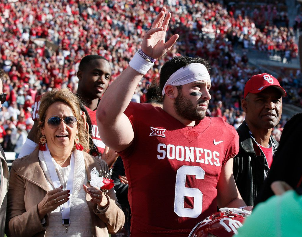low priced 955aa c23d5 WATCH: Oklahoma captains carry jersey of temporary backup QB ...