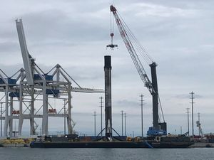 Record-setting SpaceX Falcon 9 booster returns to Port Canaveral