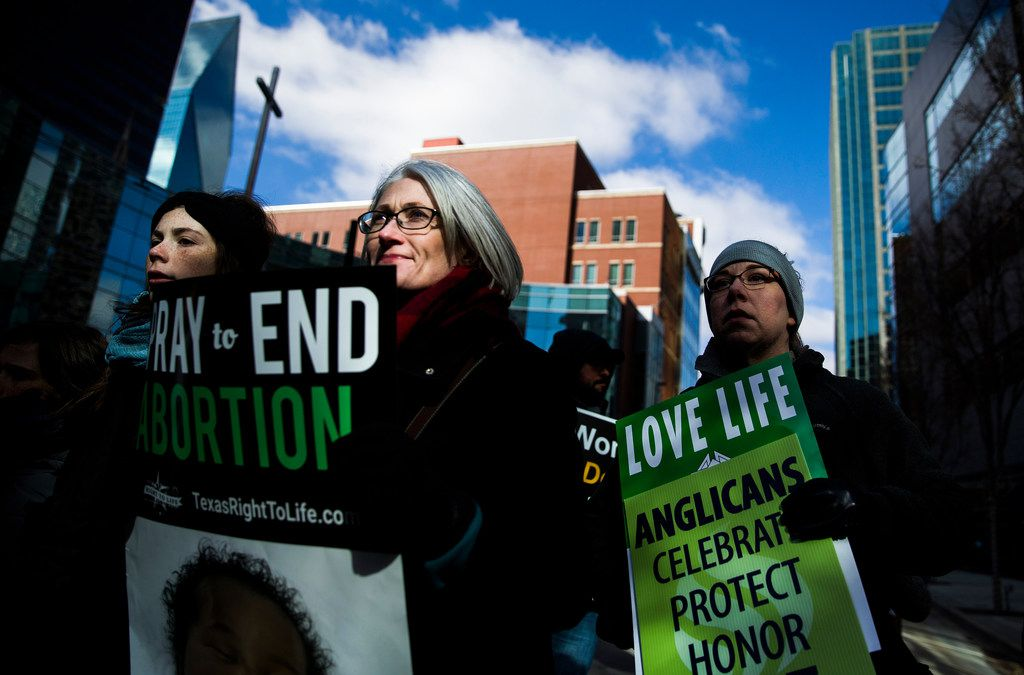 Abortion foes rally outside Dallas' federal courthouse in