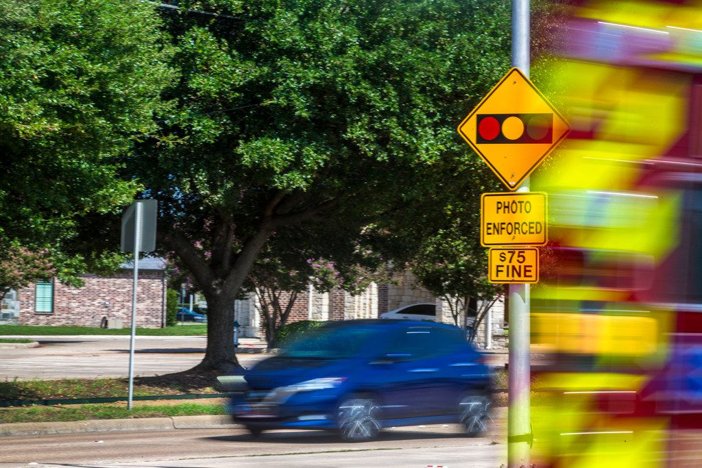 Do Texans need to pay their fines once red-light cameras are