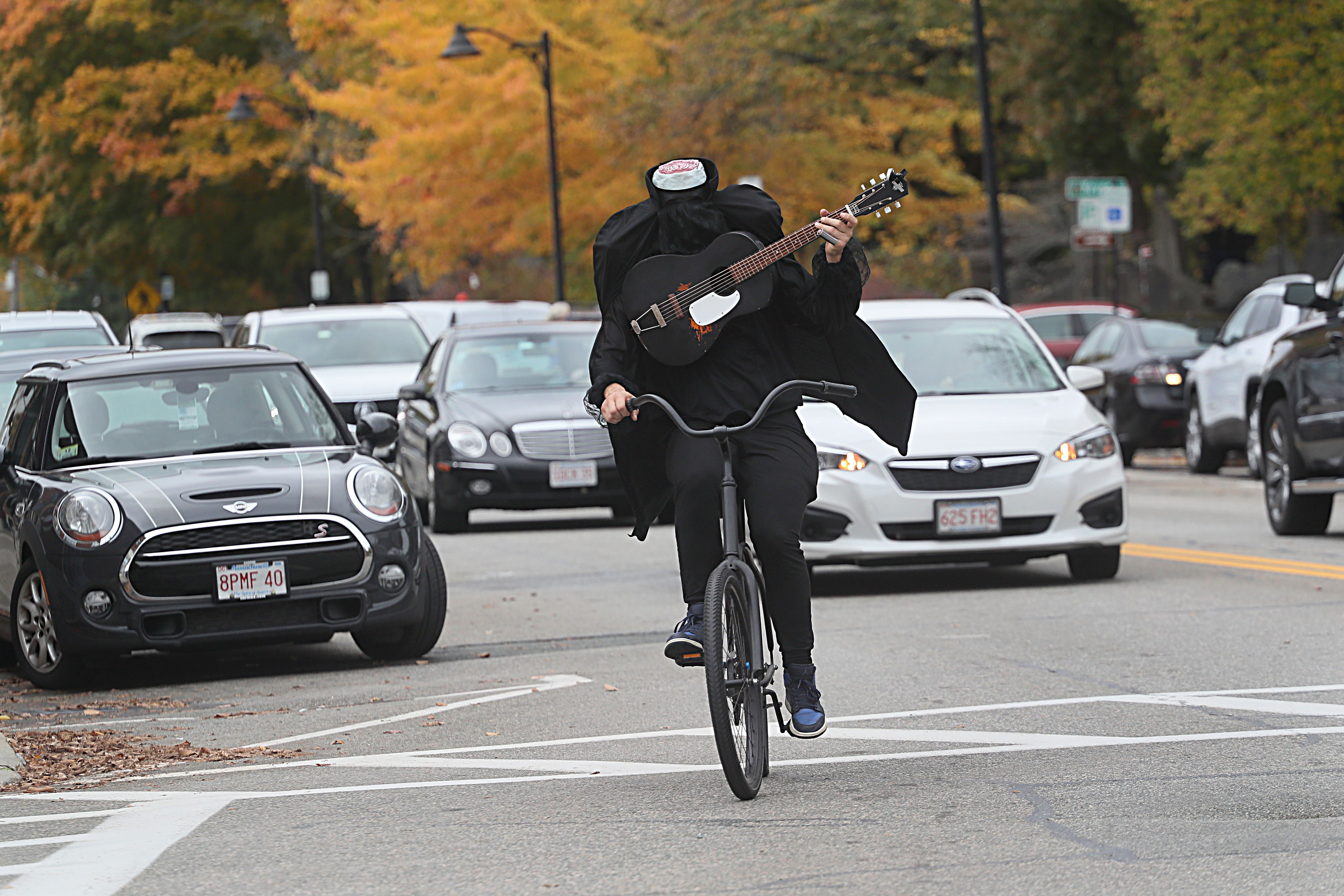 Meet The Concord Man Who Rides Around On A Bike In A Headless Horseman Costume Playing Guitar The Boston Globe
